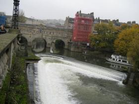 The waters of the River Avon in full winter flood at Pulteney Bridge.