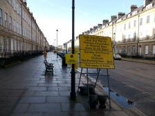 Every lamp-post covered in yellow plastic signs!