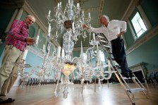 Lowering one of the ballroom chandeliers. © Heritage Services, B&NES