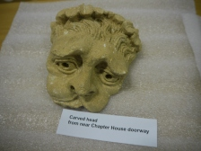 Carved head from Keynsham Abbey Chapter House.