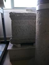 The inscribed pedestal base.