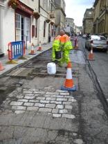 Road 'mending' in Upper Borough Walls