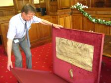 Principal Archivist Colin Johnston with the ancient charter.