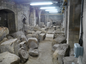 Roman monumental stones 'scattered' on the floor. An area the public would get to see.