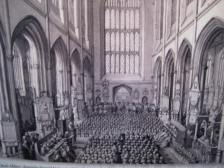 People sitting on the floor in the nave of Bath Abbey