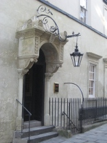 The ornate canopied side-entrance to The Huntsman
