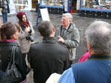 Terry Mitchell - one of the longest serving members of the Honorary Corps - taking visitors on a two hour tour of the city.