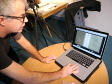 Dan checking images transferred to his online site.