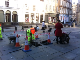 Council workmen making good the spot where the Christmas tree stood.