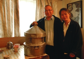 Mr and Mrs Yuk Ching Chan. He was Bath's first Chinese bus driver and arrived in 1981. The couple are pictured with the tradition steamer they brought with them as it was thought to be a useful tool for making a living. Mr Chan's mother used them to make street food to help raise ten children back in Hong Kong.