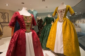 Woman's gown, yellow woven silk damask, 1740s Man's waistcoat, blue woven silk damask, 1730s Woman's gown, red woven silk damask, around 1750