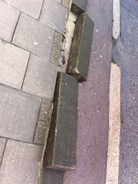 Close up of dislodged kerb edging.