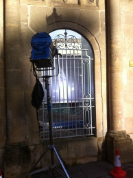 The external lamp helping to light the filming within the Cross Bath