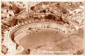 A 1950's aerial view of the Royal Crescent showing the ruins of St Andrew's Church behind.