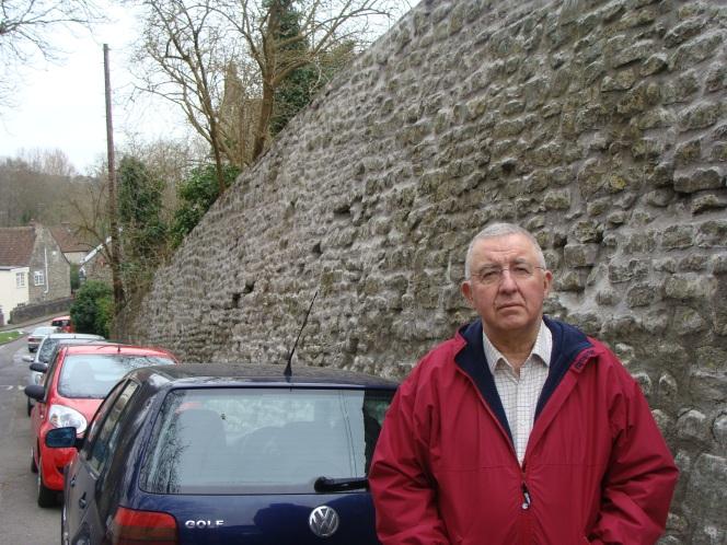 Ancient wall in Keynshamrepaired.