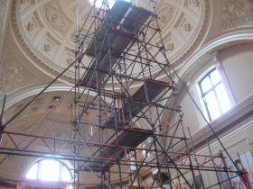 Scaffolding reaching up into the dome of the reception hall.