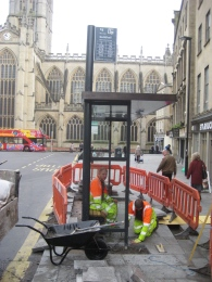 Workment busy cementing in the first High Street shelter