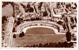 A pre-Second World War aerial view of the Royal Crescent with St Andrew's Church behind.
