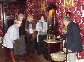 American Museum volunteer David Ryall explaining an object in the New Orleans Period Room (c. 1860)