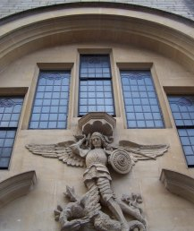 Arts and Crafts Angel over entrance to old St Michael's Church Hall in Walcot Street.