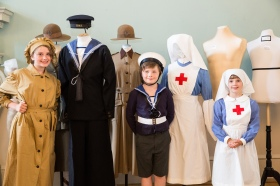 Dressing up at The Great War in Costume Exhibition at the Assembly Rooms in Bath.  Arabella Bonner (12) her brother Gabriel (9) and Aster Haydon (9). The exhibition opens on July 19th and runs to 31st August 2014.  July 2014. Photographer Freia Turland e:info@ftphotography.co.uk m:07875514528