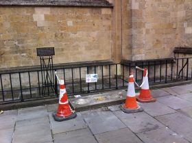 The plinth outside the east end of Bath Abbey which is minus a pig!