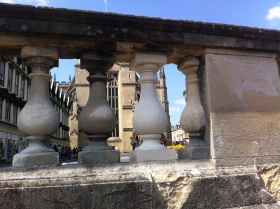 New stone spindles appearing along the balustrade.