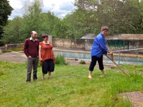 Richard and his fiancé Polly watching Trust volunteer - and friend - Sarah Kean Price doing some scything at the Cleveland Pools site.