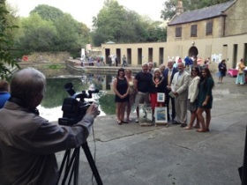 David Hallett photographs the Gray family group with Mayor Cherry Beath,  Parliamentary candidate Steve Bradley, Bath Dolphin Swimming Club president Dennis Toogood (cream suit), with our chair Ann Dunlop in the middle behind.