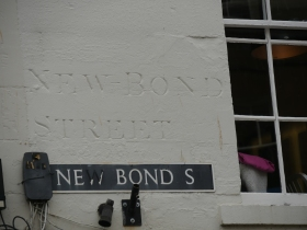 Two examples of a New Bond Street sign - neither is clear.