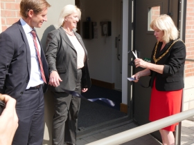 R to l Mayor of Bath, Cllr Cherry Beath cutting the ribbon and watched by Deborah Aplin, Managing Director of Crest Nicholson and Jeremy Bungey who is Head of Community Energy for E-on
