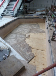The  mosaic floor taking shape again in the new Keynsham Library for the first time in nearly two thousand years.