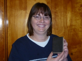 MaryJo Hayden and her copy of a First World War issued Book of Common Prayer.