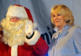 Martin in disguise and helping out the Duchess of Cornwall at a Christmas light switch-on! Photo by Sam Farr