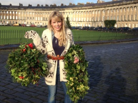 Countryfile's Ellie Harrison with Kissing Bough and garland.