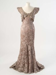 Peter Russell Evening dress and bolero of mist grey net embroidered with leaves in pink and silver metal thread, sequins, bugle beads and diamantes, about 1934