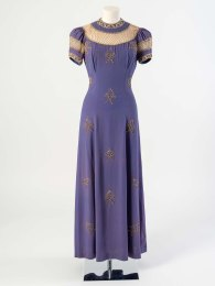 Elsa Schiaparelli Hyacinth blue silk evening dress decorated with pearl latticework and embroidered crossed key motifs in pearls, diamantes and gold beads, about 1936. This design was named The Keys of Saint Peter and was supposedly inspired by paintings at the National Gallery. Worn by Lady Jane Clark, wife of Sir Kenneth Clark, Director of the National Gallery (1934-1945)