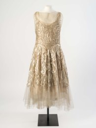 Madeleine Vionnet Cream silk net evening dress embroidered with cream silk floss in an abstract swirling design outlined in gold metal thread, about 1931. Worn by Molly Tondaiman, The Rani of Pudukkottai