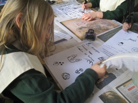 An image of a child learning to write with a quill and to illuminate a manuscript, one of the hands-on activities children will be able to enjoy as part of the half-term workshop.