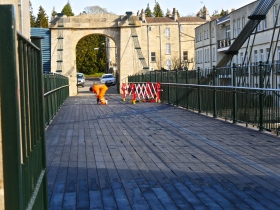 Work underway to solve the problem of the new surface lifting in places.