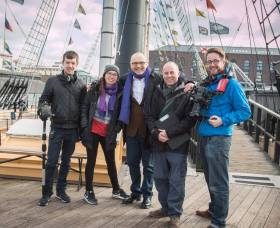 Posing with the production crew on board the ss Great Britain