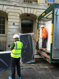 New mattresses being unloaded at the hotel's side entrance.