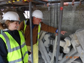 Emma Green from Benjamin&Beauchamp Architects is pictured examining the balustrade masonry with Baas Aldred from St. Michael's Without PCC.