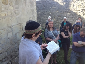 Rabbi Monique Mayer reading a prayer for the dead at the finish of the walk at the Old Jewish Burial Ground at Combe Down