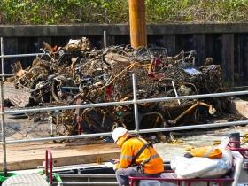 A pile of river-dumped debris on the pontoon.