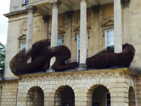 The art work weaves its way around the central portico.
