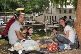 A family enjoying their picnic by the main pool