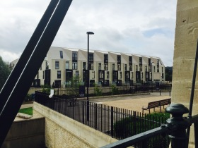 Some of the new angular town houses Crest are constructing on the riverside.