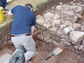 The ashlar block wall built over upright foundation slabs on the left. Presumed rough blocking appears at the left.  © Anthony Beeson