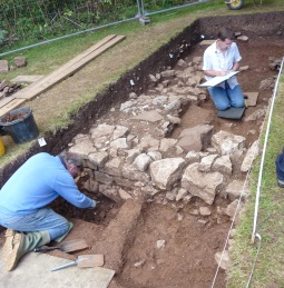 The excavation. the ashlar block wall on the left and the presumed blocking with large stones on the right.  Click on images to enlarge. © An tony Beeson